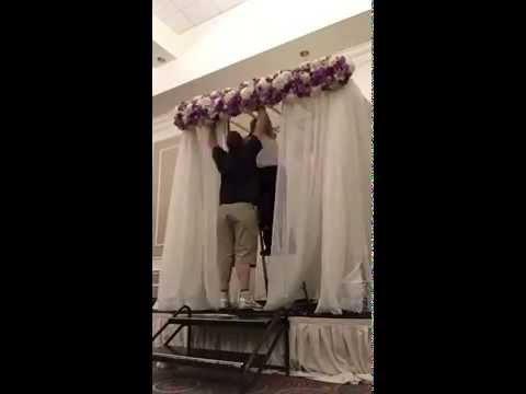 Time lapse of chuppah set up for a wedding ceremony by the Frugal Flower