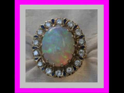 A Vintage Opal and Diamond Ring in Yellow Gold and how much money it's worth?
