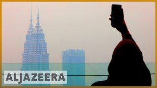 Haze blankets Kuala Lumpur, Singapore as fires rage in Indonesia
