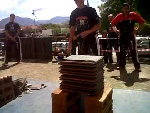 Phillip Anderson braking 10 cement roof tiles