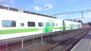 "Finnish high speed train ""Pendolino"" passes train station of Karjaa"