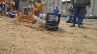 Converted Bruder Tracked loader loading dump truck
