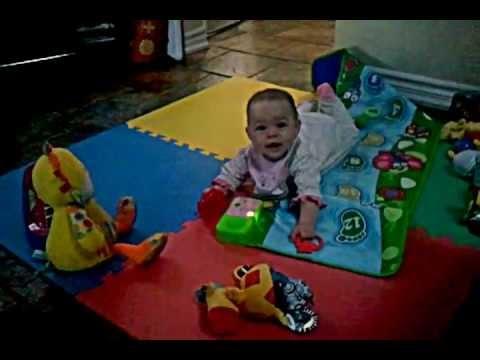 baby eva playing on music mat