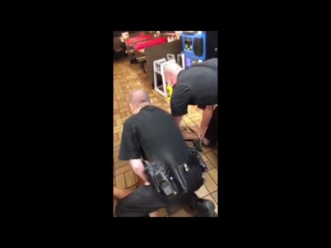 Police officers throw woman to floor during Waffle House arrest