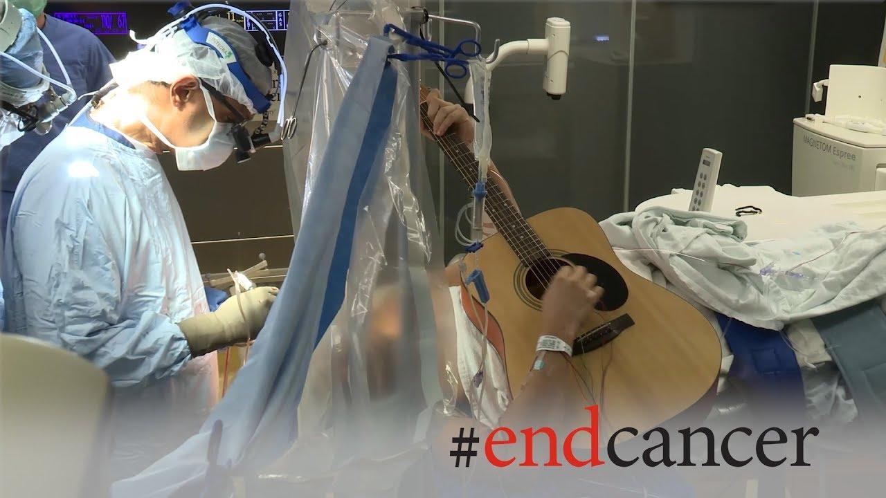 Download Brain tumor patient plays guitar during awake craniotomy surgery