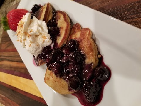 Coconut flour pancakes with blueberry maple syrup