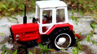 Видео про трактора. Трактора в грязи и луже. Мойка тракторов