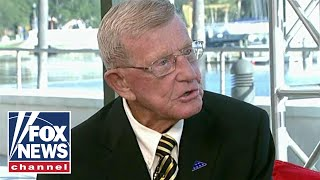 Lou Holtz on Trump attending college football's biggest game of the year