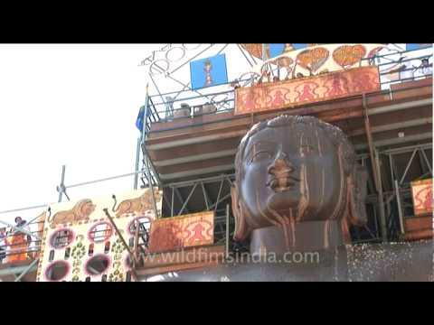 Offerings over the monolith statue of Shravanabelagola on Mahamastakabhisheka