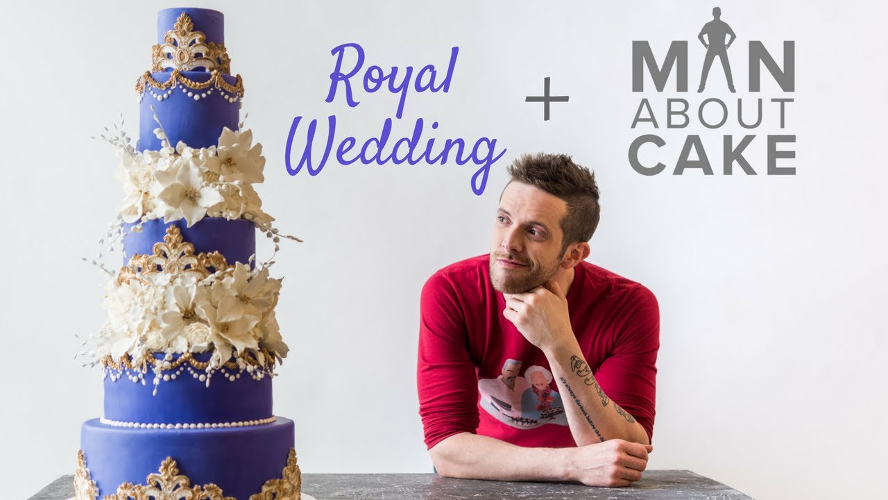 purple-royal-wedding-cake-with-gold-accents-and-white-flowers-man-about-cake