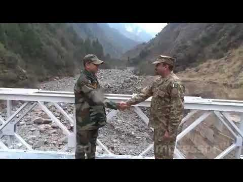 The Indian Army & Paki Army, exchanging Diwali gifts at the Kaman Post  peace bridge, at the LOC