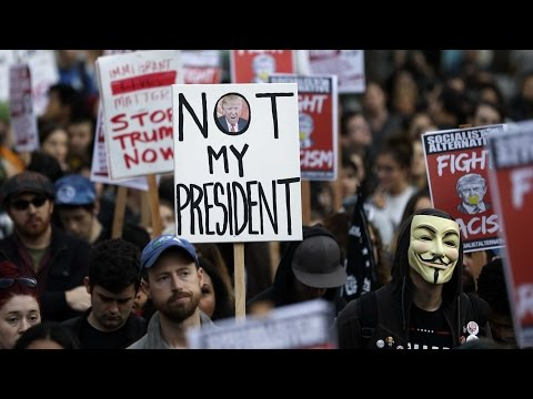 Protesters march against Donald Trump