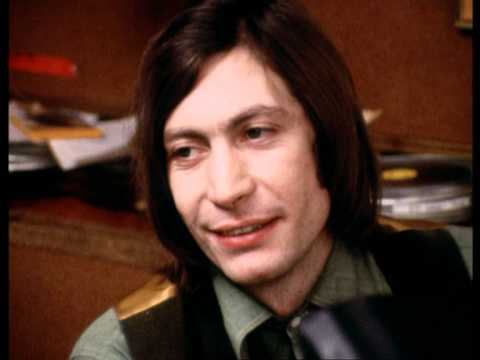 Charlie Watts & Mick Jagger listen to an Altamont Hells-Angel
