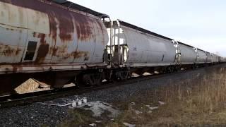 CN 435 w/ CN Engines 5779, 2156 (ex BNSF 842) & 2647 lead this long WB mixed/Autoacker train