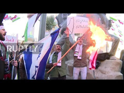 Iran: Protesters burn US, Israeli flags at rally against 'deal of the century'