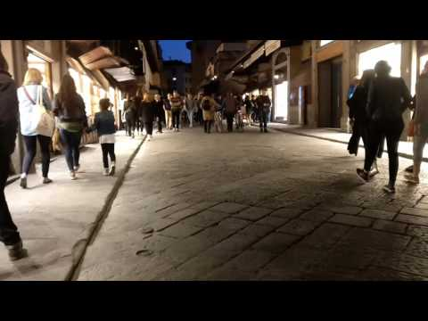 Walking across the Ponte Vecchio in Florence