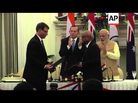 Abbott agrees uranium export deal with India's Modi