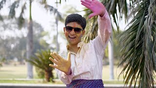 Excited Indian boy showing colorful Gulal hands during joyful Holi celebrations