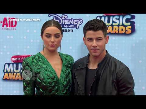 (VIDEO) Nick Jonas Olivia Culpo Cute PDA at Radio Disney Music Awards 2015