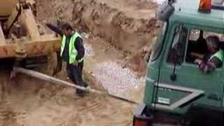 truck  stuck in mud , greece  / constructing golf course