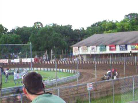 Michael Pickens passes from fourth to win Badger Midget heat