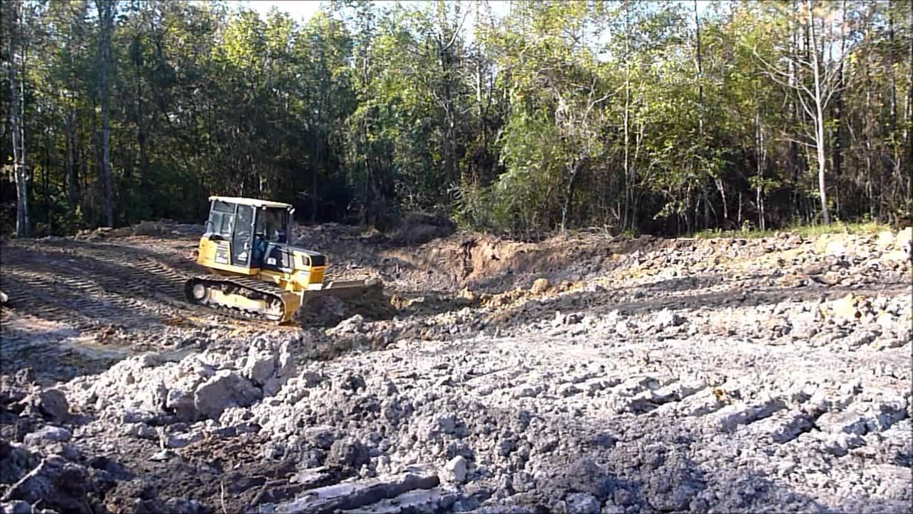 Bulldozer Digging Pond Youtube