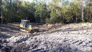 Bulldozer Digging Pond