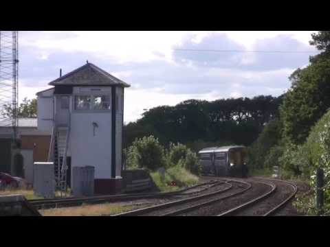Dumfries to Carlisle Sprinter approaches Annan Station 15th July 2015