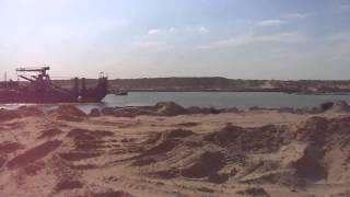 مشهد لمواقع الحفر والتكريك بقناة السويس الجديدة بالقطاع الجنوبي