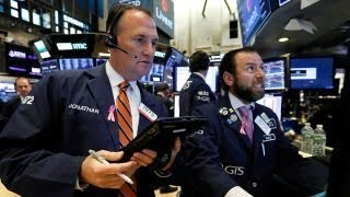 Stocks hit session lows amid global growth worries