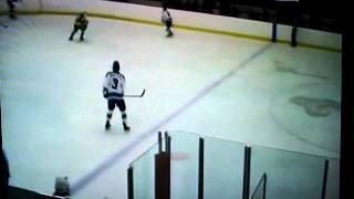 Jan 17 2015. Aaron Ryback #20 white Alexandria Picks up puck off the draw.