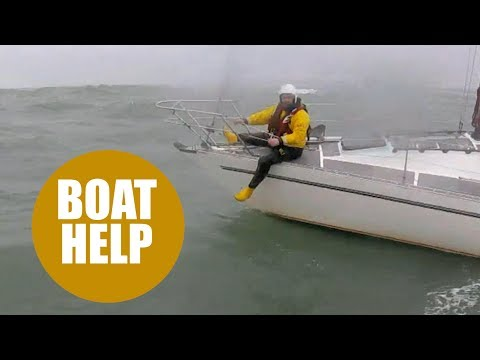Lifeboat crew struggle to save stricken yacht