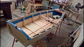 Slideshow of construction. No plans. Make it up as you go; oars too. Built from 2 sheets of marine plywood, Tasmanian oak stringers