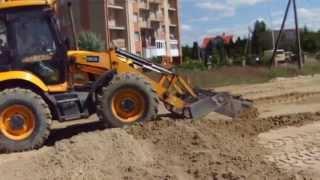 Выравнивание площадки под автостоянку трактором JCB - steh39.ru