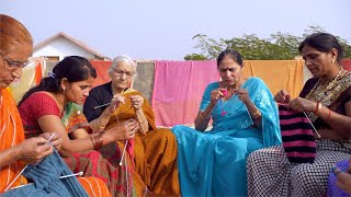 Group of an Indian women knitting winter clothes - Self Help Group
