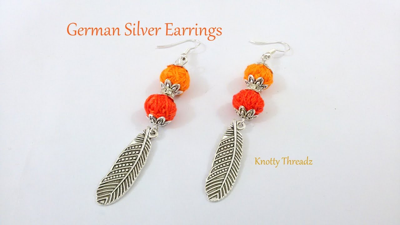 German Silver Designer Earrings Feather Hangings In 2 Mins Knottythreadz