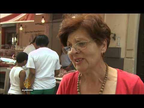 Migrant influx worries Sicilian city locals