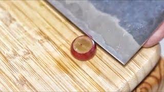 SLICING A GRAPE WITH A SUPER SHARP KNIFE