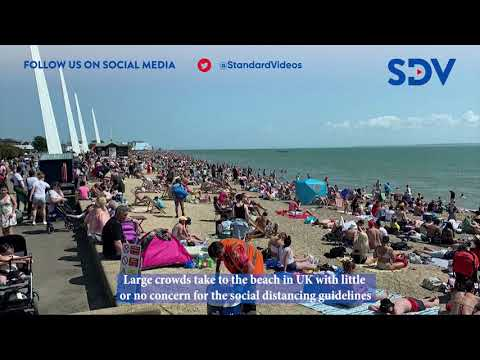 Large crowds take to the beach in the UK with no concern for the social distancing guidelines