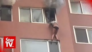 Woman trapped hanging outside 8th floor window in house fire