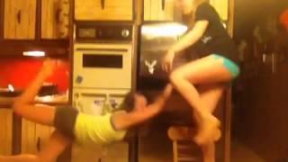 Teen girl falls off chair doing stretch