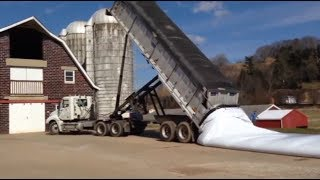 Unloading of grain from a trailer of a dump truck into one bag