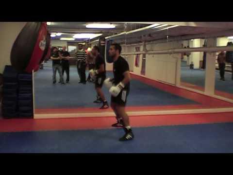 Isam Khalil hitting bag