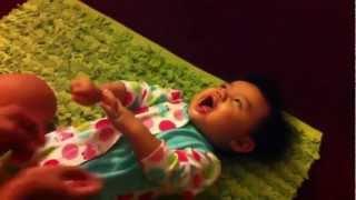 Daddy tickling cute baby