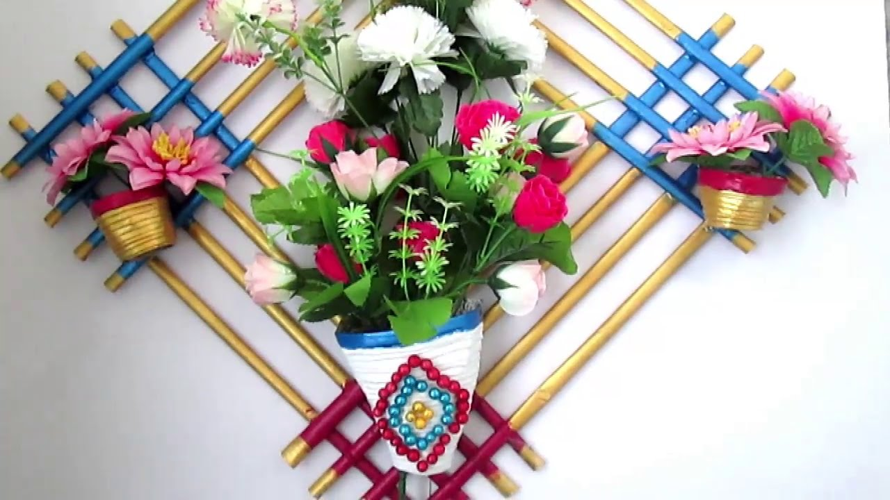 Newspaper flower vase diy newspaper crafts best out of for Wall hanging out of waste material