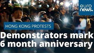 Pro-democracy demonstrators in Hong Kong mark six months of protests