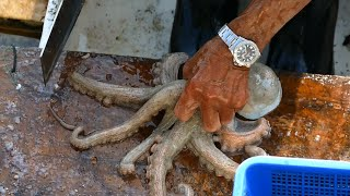Cutting Live Octopus in Sai Kung seafood market, Hong Kong