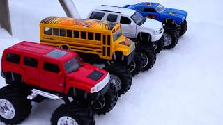 Toy cars moving off a large snowy mountain video for kids.