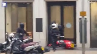 Shocking moment thugs with sledgehammers use moped to ram open doors of Oxford Street jewellers