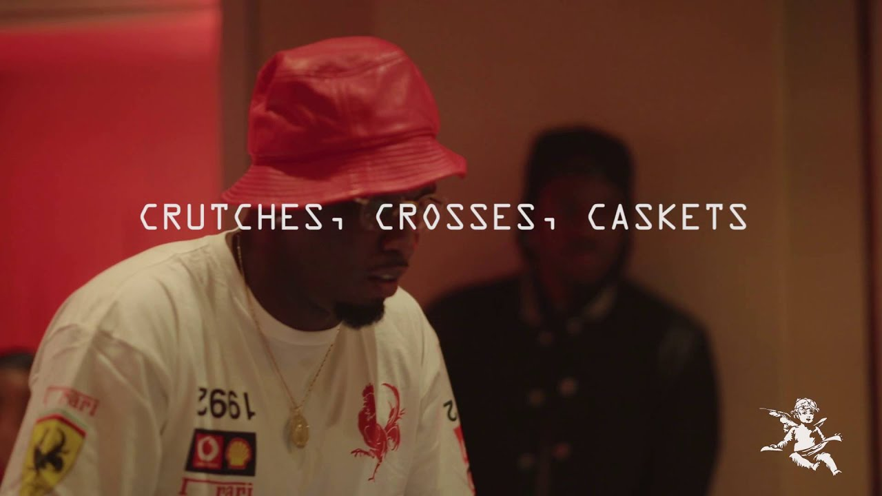 pusha t crutches crosses caskets